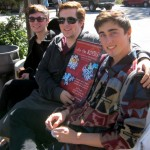 (from L) Idyllwild Arts students Paul, Jake and Chase pause before they hang show posters around Idyllwild.