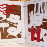 Alison Yates' art book was done in red, white and black on wood panels