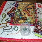 Amanda sold excess beads over Fourth of July Weekend to pay for her upcoming class with B