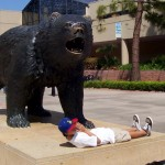 A fan mugs it up in front of the UCLA bruin on campus