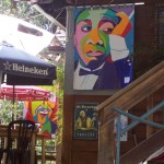Louis Armstrong art banner at Cafe Aroma. A summer jazz student wrote a song about a club in New Orleans where Sachmo hung out. It will be played at the IAF Theater on Saturday.