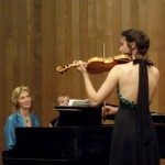 Charlie Clist plays violin as her mom accompanies her on piano