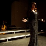 "Dressed in a black sequin dress, Lori Palmer sings her heart out in ""What is this Thing Called Love?"""