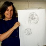 Jessica Shiffman holds up a portrait of herself that one of her student's drew