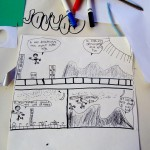 Connor illustrates one of his comics for class