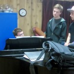 (from L) Kevin, Julian, Will, Nick and Corwin gather around the piano