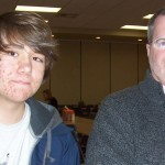 (from L) Comp music student, Arik, and his teacher, Kevin Michael Sullivan, discuss the merits of the class