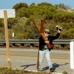 Wes walks with his cross to help avert natural disasters