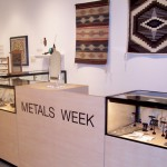 Jewelry case showcasing the work of Metals Week artists