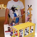 Neil looks at some of the wooden Native American toys in the show