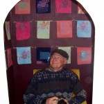 Vance sits inside Natania's installation with prints inside