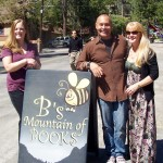(from R) Mary Otis and Eduardo Santiago pose with the owner of B's Mountain of Books