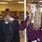 Students would ask each other for input. Here, Tenaya holds up a sheer blouse for Eve.
