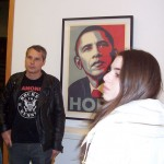 Shepard Fairey with iconic Obama poster and student.