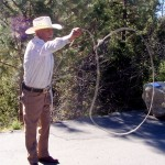 Samuel Perez, 77, from San Jacinto, shows off his roping skills while he sells hard wood in Idyllwild