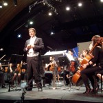 Peter Askim introducing Shearer and the IA orchestra