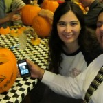 Mia, Randy and their John Beluchi pumpkin (with cell phone image)