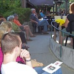 """Audience members and diners listen intently to James Brown read from his new book, """"This River"""""""