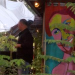 Eduardo Santiago introduces James Brown on Cafe Aroma's deck with bright banners