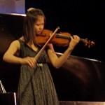 14-year-old Manjie performing on her violin