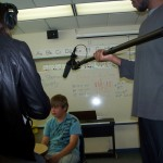 IA students Amelia (L) and Joel (R) interview a grade school student in one of the piano labs