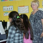 Teacher and students in a piano lab sponsored by The Steinway Society