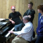 (from L) Nicky, Will and Corwin listen to their instructor, Kevin Sullivan