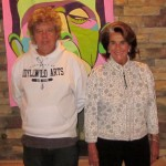 UCLA Bruins fan Jeffrey Taylor with Sara Karloff. Monster art by Marcia Gawecki