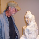 "Wayne Parker inspects ""The Shower"" sculpture by Angelica"