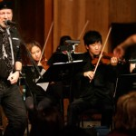 """Guitar legend Richard Thompson with string students during """"Cabaret of Souls"""" last year"""