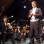"""Xiao Fan (at L with Peter Askim), will play a violin solo during the """"Young Virtuosity!"""" orchestra concert this weekend"""